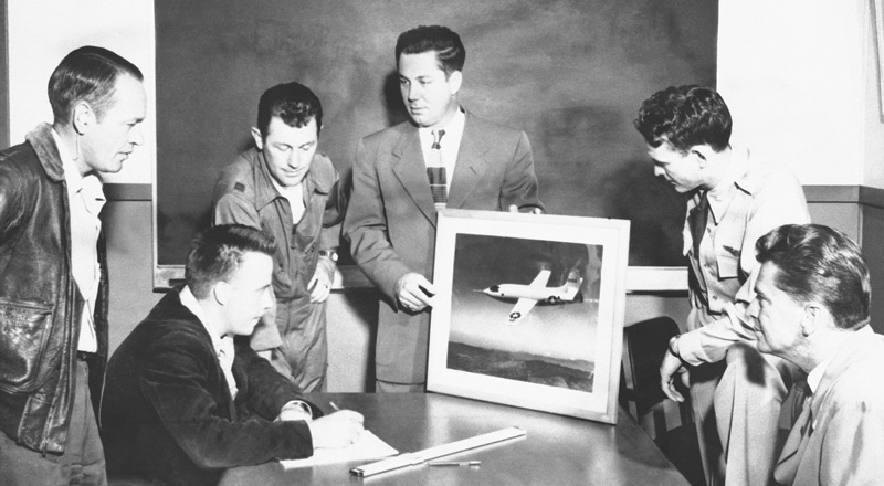 Key members of the XS-1 Research Team NACA Muroc Flight Test Unit XS-1 Team members and USAF Pilots. From Left to Right: Joseph Vensel, Head of Operations; Gerald Truszynski, Head of Instrumentation; Captain Charles Chuck Yeager, USAF pilot; Walter Williams, Head of the Unit; Major Jack Ridley, USAF pilot; and De E. Beeler, Head of Engineers. (Image # E95-43116-5)